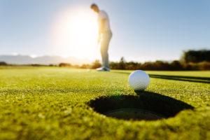 Man Putting golf ball | CBMC Golf Tournament Omaha